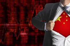 Fond de diagramme de marché boursier avec montrer un super héros Photo stock