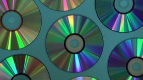 Fond de disque de CD ou de DVD de cru, vieux disques de cercle utilisés pour le stockage de données, films de part et musique clips vidéos