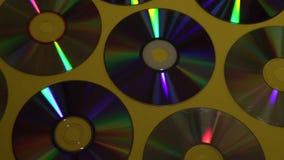Fond de disque de CD ou de DVD de cru, vieux disques de cercle utilisés pour le stockage de données, films de part et musique banque de vidéos