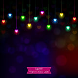 Fond de fête avec les lumières en forme de coeur Photo stock