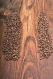 Fond de grain de café sur le bois photos stock