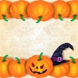Fond de Halloween avec des frontières des potirons et du chapeau Images stock