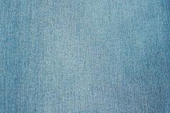 Fond de jeans de textile bleu de denim Images stock