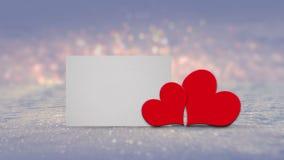 Fond de jour de valentines avec deux coeurs rouges Image libre de droits