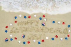 Fond de jour des Etats-Unis de l'indépendance sur la plage Photos stock