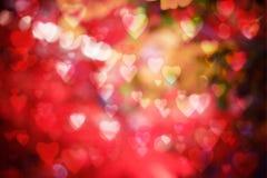 Fond de jour du ` s de Valentine bokeh brouillé avec le style de bokeh de coeurs copiez l'espace pour ajouter votre texte ou l'em Photos libres de droits