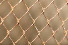 Fond de la barrière de maille en métal Photographie stock