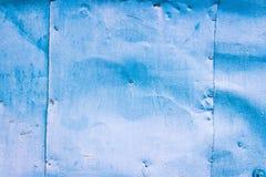 Fond de métal peint dans le bleu Métal écrasé peint dans le bl Images libres de droits