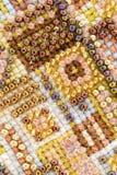Fond de métier de broderie de perle, Photos stock
