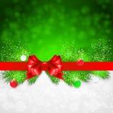 Fond de Noël avec des brindilles et Noël de sapin Images libres de droits