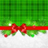 Fond de Noël avec des brindilles et Noël de sapin Photographie stock libre de droits