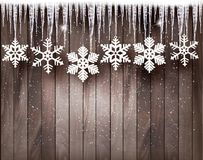 Fond de Noël avec des flocons de neige et des glaçons Image libre de droits