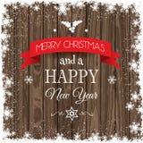 Fond de Noël avec la frontière neigeuse et la texture en bois Image libre de droits
