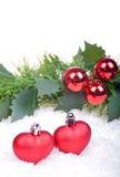 Fond de Noël avec les boules rouges, coeurs Photographie stock libre de droits