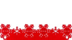 Fond de Noël avec les flocons de neige rouges et l'espace de copie d'isolement sur le fond blanc Photo libre de droits