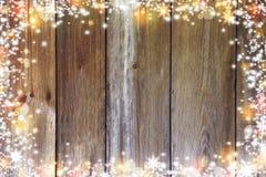 Fond de Noël avec les lumières, le bokeh, les étoiles et la neige Vieux boa Photographie stock