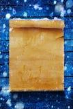 Fond de Noël, défilement de papier couvert de neige Images stock