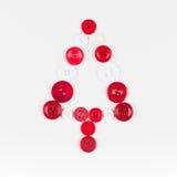 Fond de Noël d'arbre de boutons blancs et rouges, d'isolement sur le blanc avec l'espace de copie Photo stock