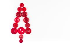 Fond de Noël d'arbre de boutons blancs et rouges, d'isolement sur le blanc avec l'espace de copie Photographie stock
