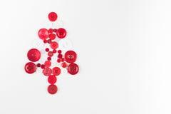 Fond de Noël d'arbre de boutons blancs et rouges, d'isolement sur le blanc avec l'espace de copie Photos stock