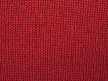 Fond de Noël de laine rouge tricotée par rouge Photo libre de droits