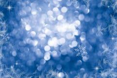 Fond de Noël fond Defocused vacances de scintillement bleu d'abrégé sur avec des étoiles de clignotement Bokeh brouillé images stock