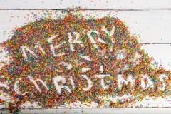 Fond de Noël Joyeux Noël écrit avec la couleur arrosant sur le fond en bois de turquoise Images libres de droits
