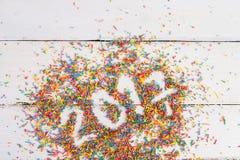 Fond de Noël Joyeux Noël écrit avec la couleur arrosant sur le fond en bois de turquoise Photographie stock