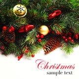 Fond de Noël Pensionnaire de Noël avec la branche d'arbre de sapin avec les cônes et l'ornement Babioles de Noël dans la couleur  Photo libre de droits