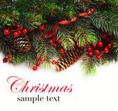 Fond de Noël Pensionnaire de Noël avec la branche d'arbre de sapin avec les cônes et l'ornement Babioles de Noël dans la couleur  Image stock