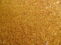 Fond de pétillement d'or Photographie stock libre de droits