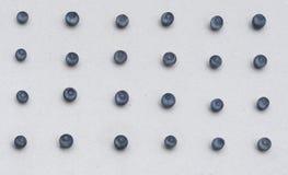 Fond de papier avec les myrtilles bleues Élément approprié de conception pour la salutation saisonnière, carte, bannière Photographie stock