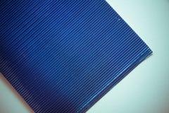 Fond de papier métallisé par bleu Photographie stock