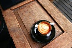 Fond de petite flûte chaud de latte Photo stock