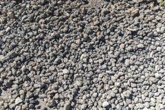 Fond de petites pierres grises de lave Images stock