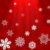 Fond de place rouge de Noël avec des rayons et des flocons de neige Image libre de droits
