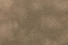Fond de plan rapproché en bronze léger de tissu de suède Texture mate de velours de textile de nubuck de sable Images stock
