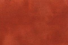 Fond de plan rapproché orange-foncé de tissu de suède Texture mate de velours de textile de nubuck de gingembre Images stock