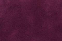 Fond de plan rapproché pourpre foncé de tissu de suède Texture mate de velours de textile de nubuck de vin Photographie stock