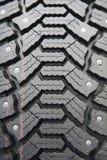 Fond de pneu noir de l'hiver Photo stock