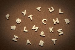 Fond de qualité de studio de biscuits d'alphabet Photographie stock libre de droits