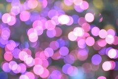 Fond de rose et de lumières de Noël brouillées pourpres images stock