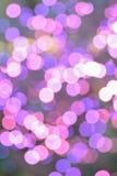 Fond de rose et de lumières de Noël brouillées pourpres image stock