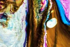 Fond de rouge, rose, vagues bleues, brunes, vertes d'encre photo libre de droits