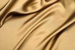 Fond de satin d'or Photo stock