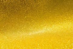 Fond de scintillement d'or brouillé par résumé Image libre de droits