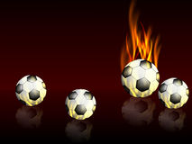 Fond de sports avec des ballons de football avec des réflexions et des flammes Photo libre de droits