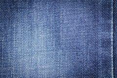 Fond de texture de tissu de jeans de denim avec la couture pour la conception Photos stock