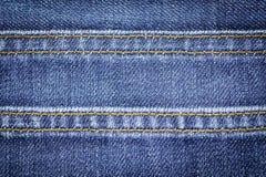 Fond de texture de tissu de jeans de denim avec la couture pour la conception Image libre de droits