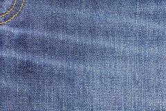 Fond de texture de tissu de jeans de denim avec la couture pour la conception Photo stock
